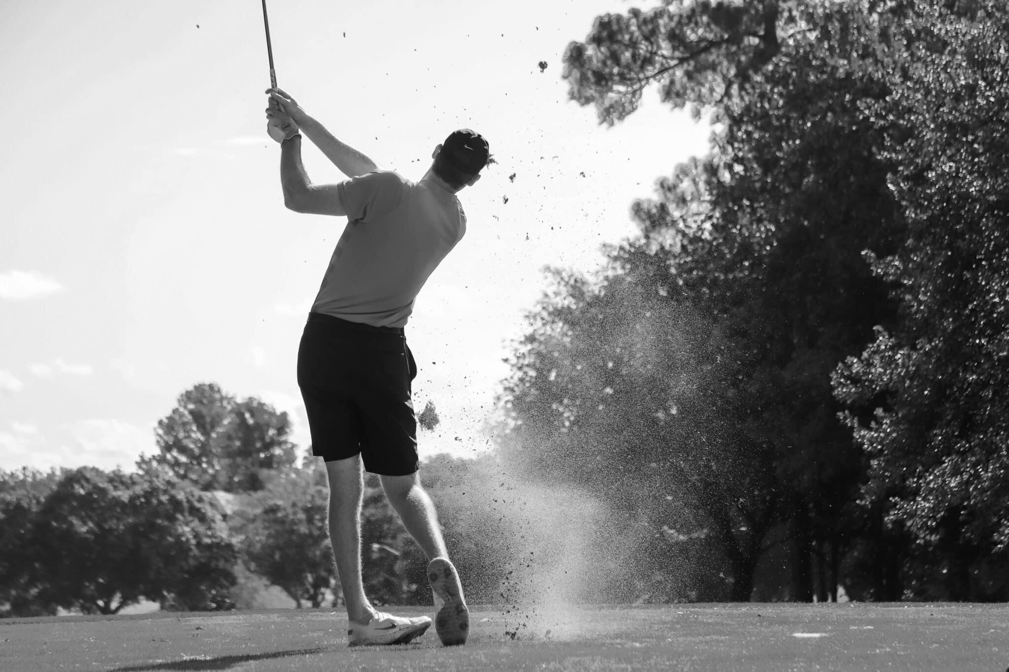 Person hitting golf ball